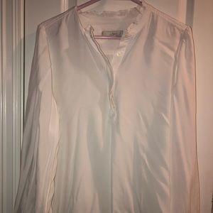 White long sleeve tunic ruffle neckline